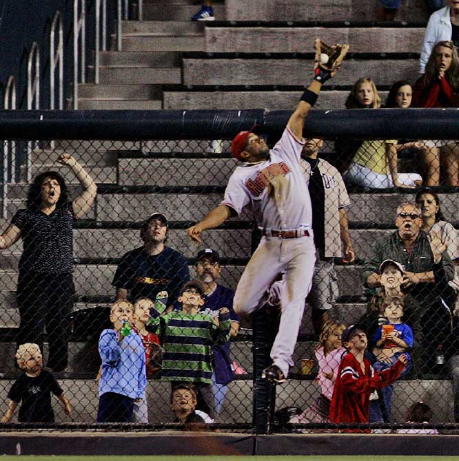 D-backs centerfielder Chris Young robs the Padres' Mike Cameron of a grand slam to end the fifth inning Aug. 1 at PETCO Park. Arizona won 9-5 in 11 innings.