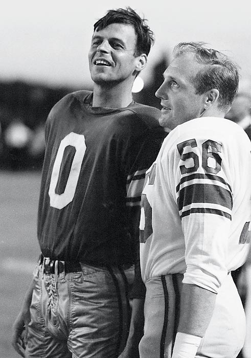 Plimpton with Detroit's Joe Schmidt.