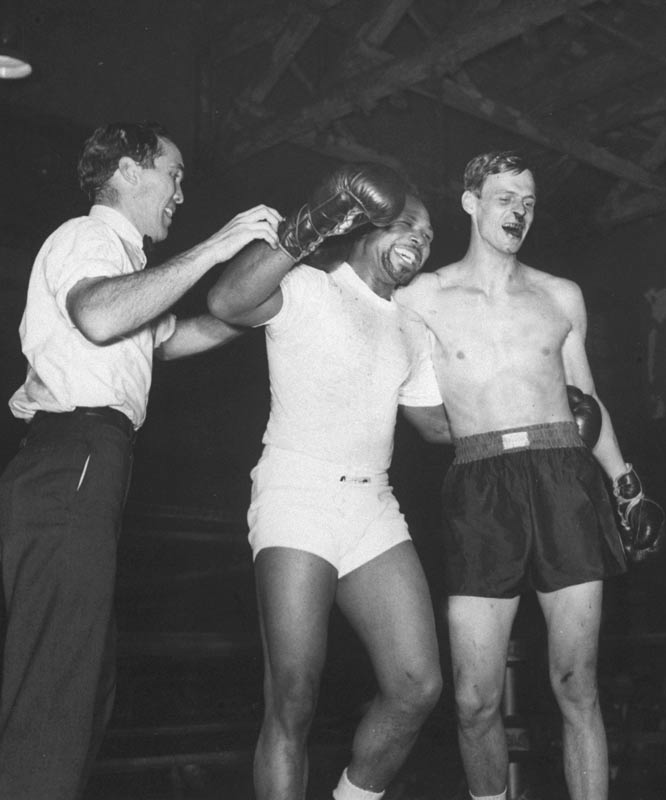 The late George Plimpton was the first journalist to see what it was like to play professional sports by participating in them. From boxing with the heavyweight champ to playing goalie with the Boston Bruins, here are his experiences.<br><br>A 1959 exhibition fight with heavyweight champ Archie Moore left Plimpton with a bloody nose.