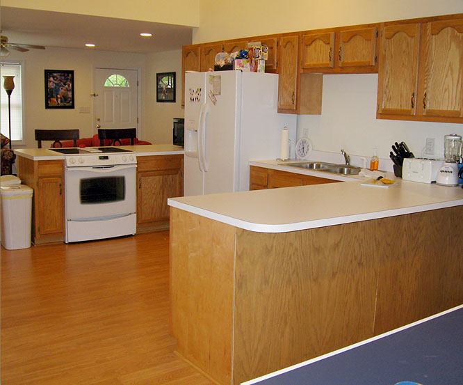 And now to the kitchen.  The house may look quaint and petite from the outside but, umm, ... not so much.  For college students, let alone any home owners, the kitchen ain't bad ...