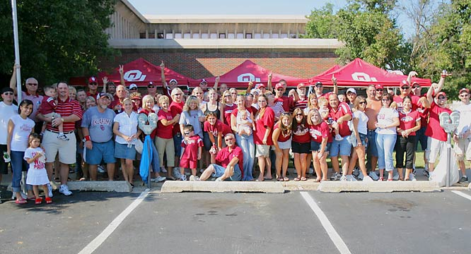 Oklahoma fans enjoy the tailgate prior to the Sooners' 79-10 whooping of the University of North Texas.