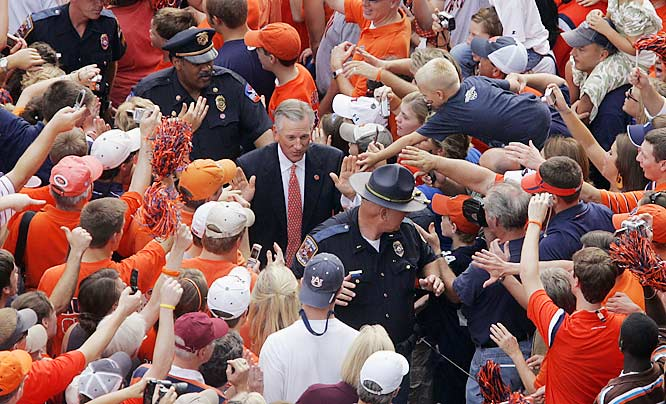 "Auburn coach Tommy Tuberville is surrounded by fans during the ""Tiger Walk"" at Jordan-Hare Stadium prior to the Tigers' game against Kansas State."