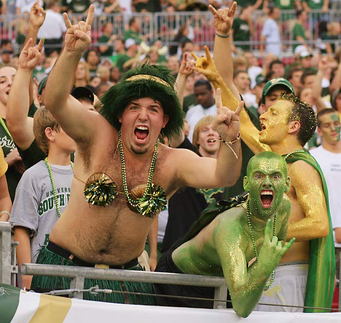 We're not sure what's scarier -- the bikini top on one fan or the intense expression on his friend's face.