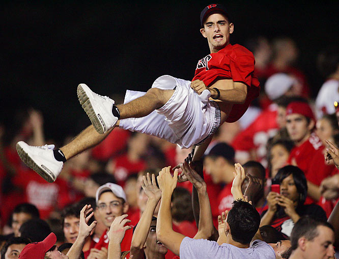This Rutgers fan gets airborn during the fourth quarter of Friday's game against Navy.