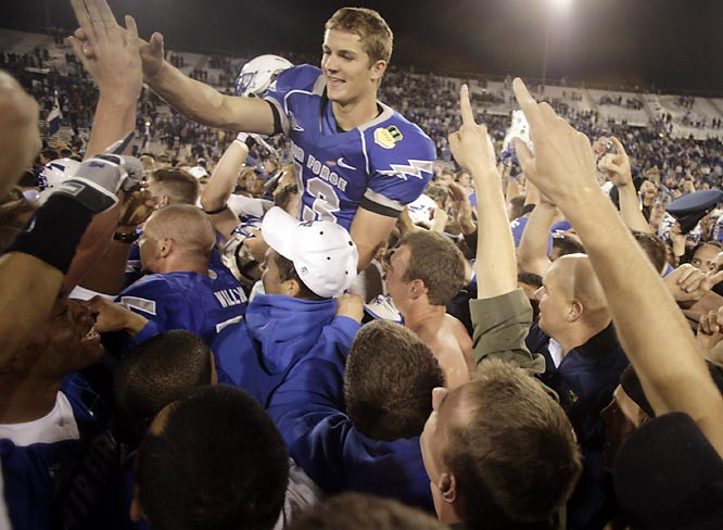 Air Force kicker Ryan Harrison is carried off the field  after kicking the winning field goal in overtime to give the Falcons a 20-17 victory over TCU.