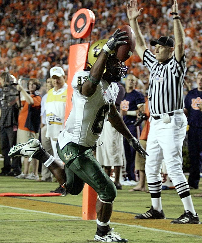 South Florida receiver Jesse Hester scores the winning touchdown in overtime at Auburn, giving the Bulls their first victory over a Southeastern Conference team.