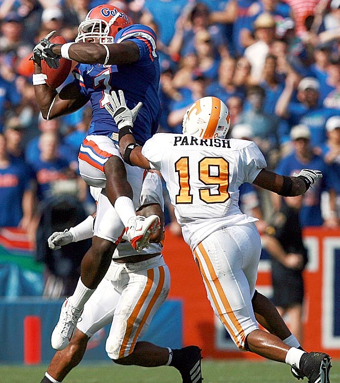 Tight end Cornelius Ingram hauls in a Tim Tebow pass over defensive back Jarod Parrish. Ingram had 56 yards and a touchdown for the Gators.