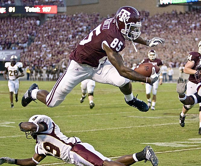 Texas A&M tight end Martellus Bennett leaps over Louisiana-Monroe's Chance Payne after making one of his six catches. Bennett finished with 98 yards receiving.