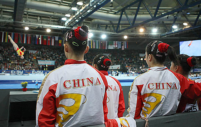 Watch out: the Chinese (pictured here watching the disastrous floor event) finished less than a full point behind the States, leaving the team in good position to overtake the U.S. next year.