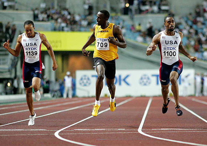 Tyson Gay (right) added the title of the fastest 200-meter runner in world championship history to complete a 100-200 double.