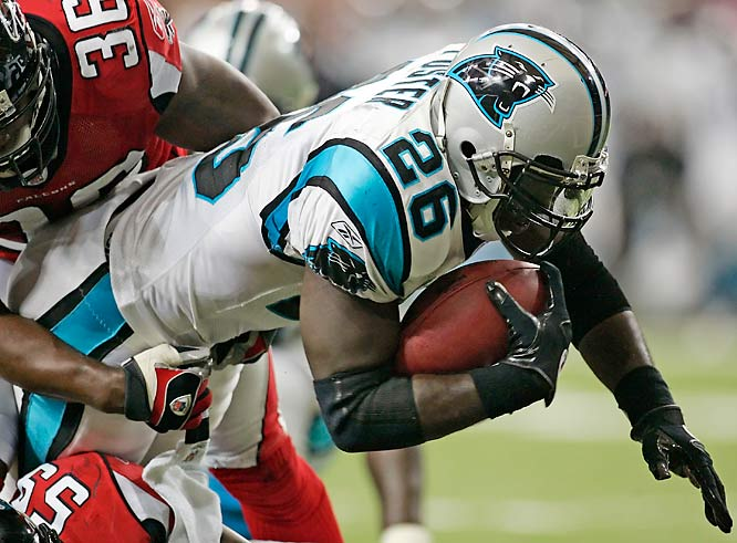 DeShaun Foster rushed for 122 yards and scored two touchdowns in a game in which Panthers starting quarterback Jake Delhomme left with an injured throwing arm.