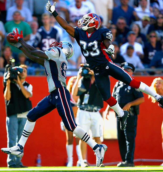 Randy Moss pulls down a 45-yard touchdown pass in front of Jabari Greer. Moss scored twice and had 115 yards receiving, becoming the first wideout in NFL history to gain at least 100 yards receiving in each of his first three games with a new team.