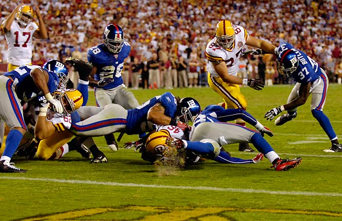 Linebacker Kawika Mitchell and the Giants defense stop Ladell Betts on 4th and 1 for the win.