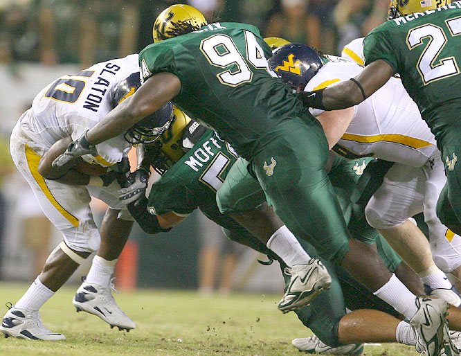 South Florida's defense stifled West Virginia's Steve Slaton, allowing the Heisman candidate 54 yards on the ground as the Bulls beat the Mountaineers for the second straight year.