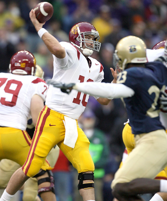 John David Booty threw for 236 yards and a touchdown as the Trojans survived a scare from Washington to win for the 60th time in 64 games.