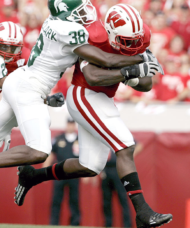 P.J. Hill ran for 155 yards and two touchdowns on 34 carries as the Badgers extended the nation's longest winning streak to 14 games.