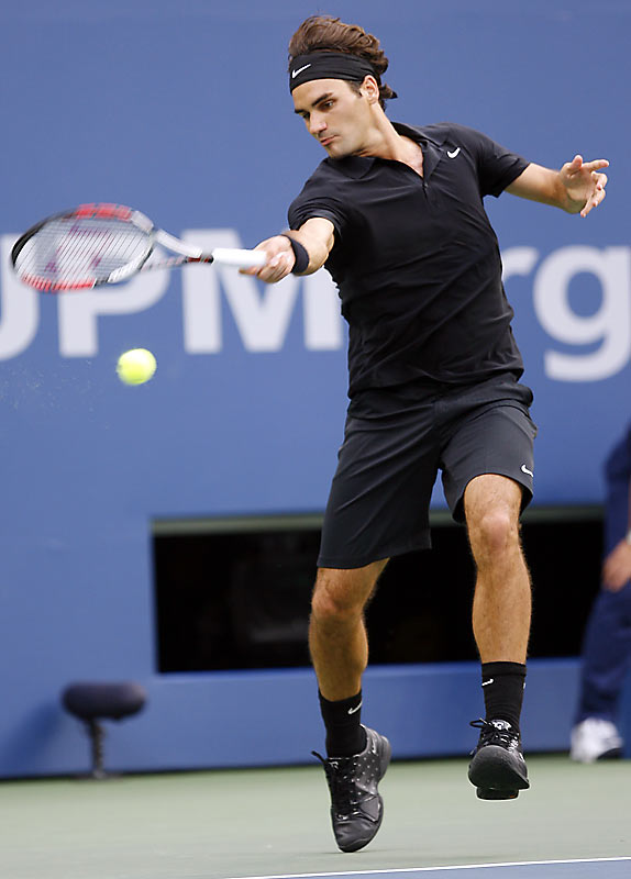 "Dressed in his ""Darth Federer"" outfit for the night matches, Roger Federer improved to a 12-2 lifetime record in Grand Slam finals with his championship win over Novak Djokovic."