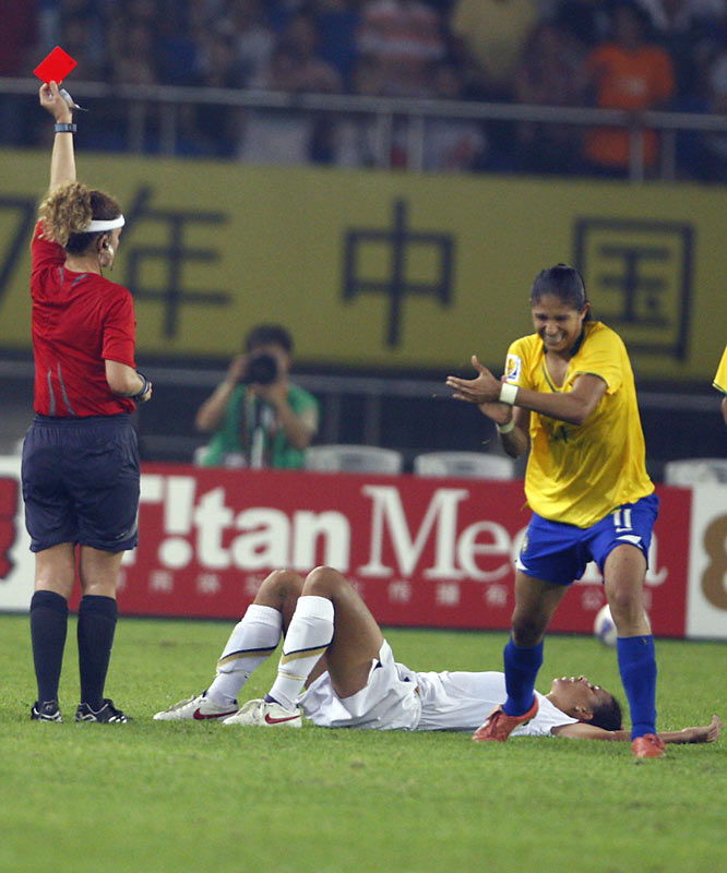 Shannon Boxx lies on the ground in disbelief after being called for a red card.