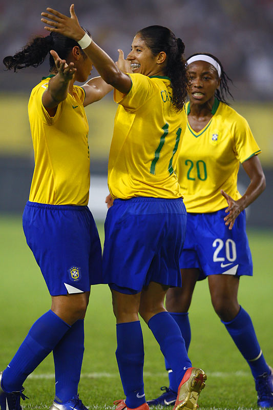 After putting Brazil up 3-0, Cristiane embraces her teammates.
