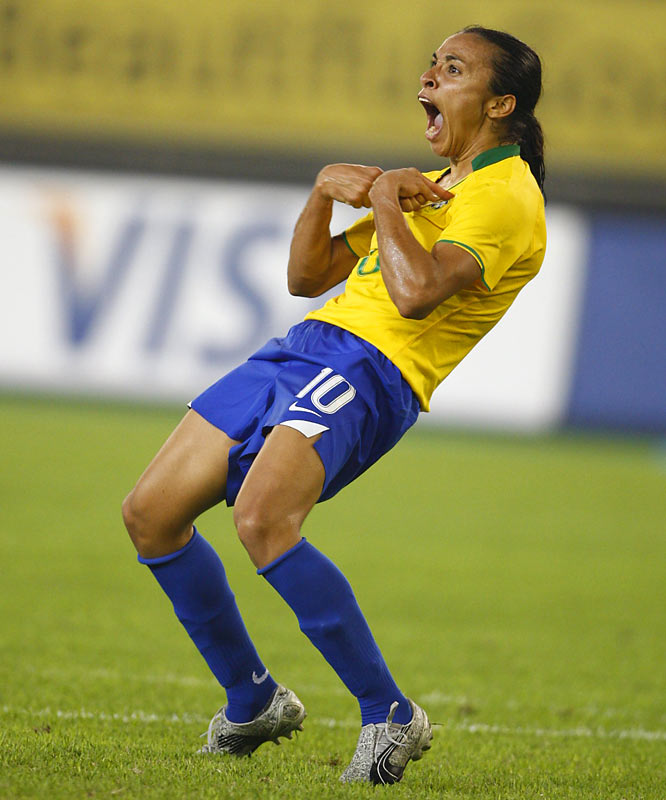 Marta is ecstatic after weaving through defenders on the way to a second goal.