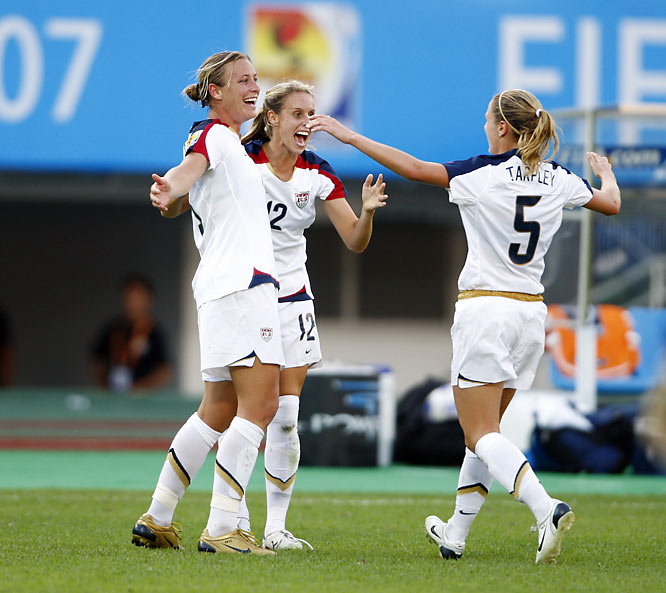Abby Wambach celebrates with teammates Leslie Osborne and Lindsay Tarpley after her second goal.
