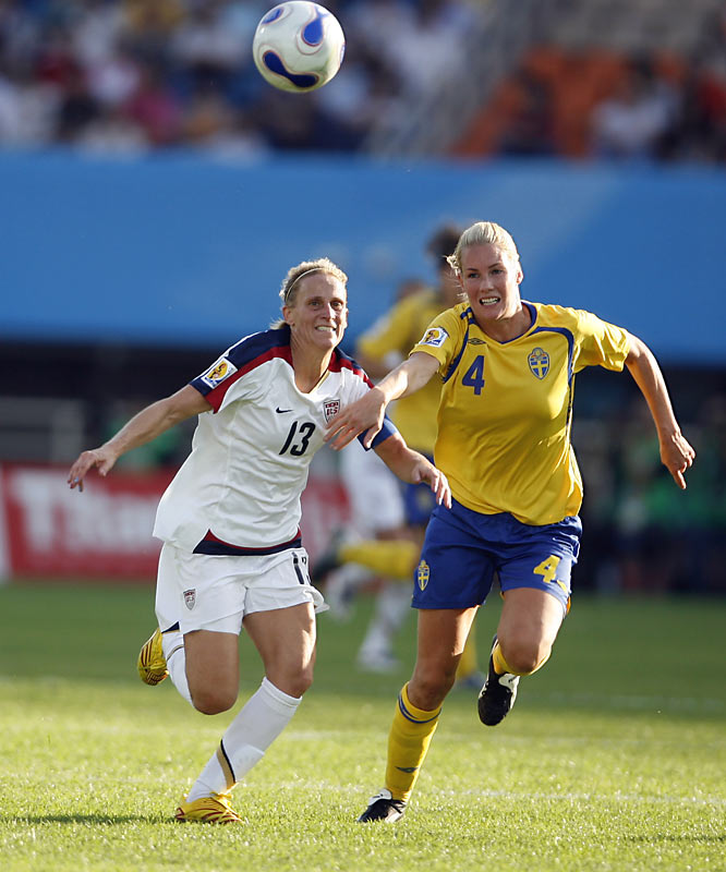 Kristine Lilly, shown here battling with Hannah Marklund, is playing her first World Cup at striker.