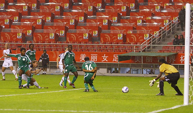 Lori Chalupny, behind Nigeria's Rita Chikwelu (10), deflects a shot off Ulumma Jerome and past goalkeeper Precious Dede to score 55 seconds into the game, the second fastest goal in women's World Cup history.