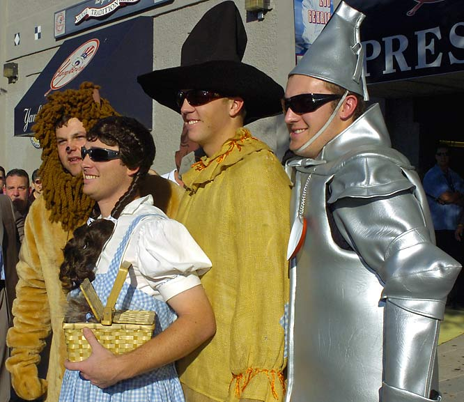"New York Yankees' Joba Chamberlain is dressed as the Lion, Ian Kennedy as Dorothy, Shelley Duncan as the Scarecrow and Phil Hughes as the Tin Man from ""The Wizard of Oz"" as they leave Yankee Stadium after Monday's game. The rookies had to dress in costumes as part of a hazing ritual before they left for a road trip."