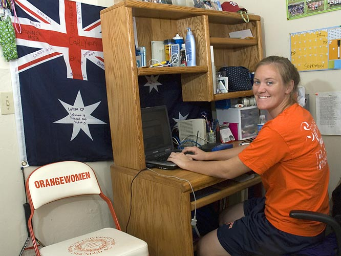 Behind midfielder Bridget Looney's desk is an Australian flag bearing the signatures of teammates from the lacrosse team Looney played on while in Australia two summers ago.