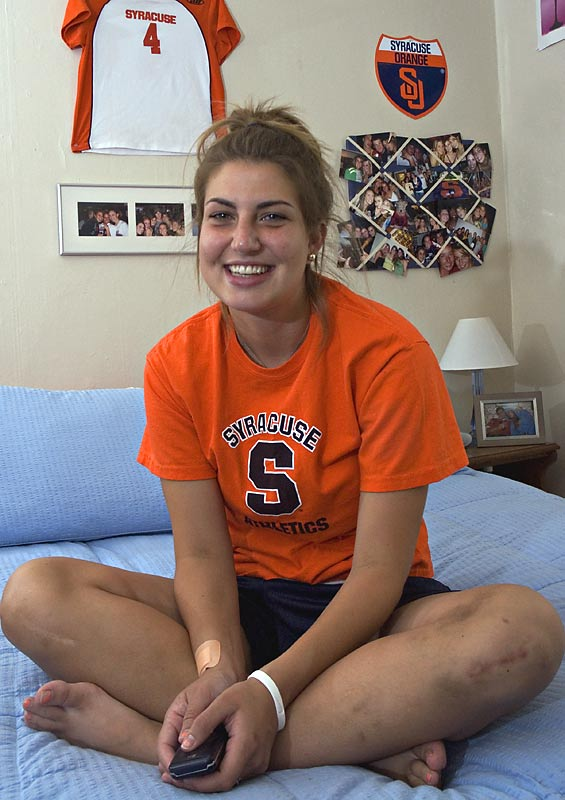 Defender Stephanie Bissett decided her old Syracuse lacrosse jersey was the perfect decoration for above her bed.