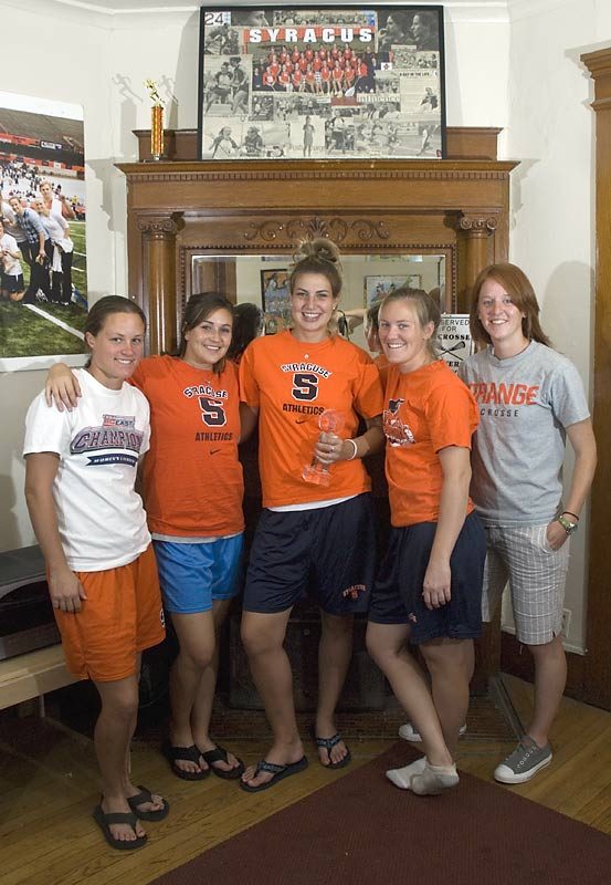Many reminders of past success -- including the 2007 'Cuse Award for best team and the 2007 Big East Championship trophy and poster -- line the living room and motivate Brady, Gibson, Bissett, Looney, Brushe and the preseason No. 4 Orange for the season ahead.