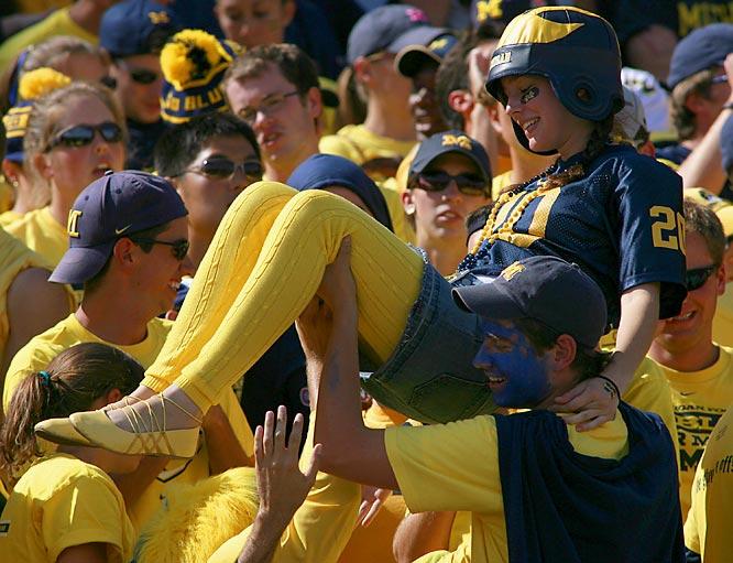 A Michigan fan does a little crowdsurfing after a first quarter touchdown.