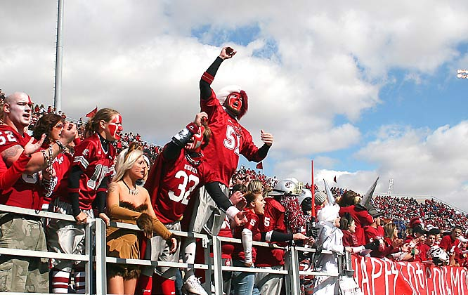 The Washington State student section cheer on the Cougars during their 23-20 loss to Arizona State.