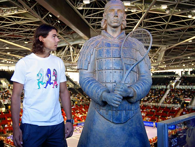 Rafael Nadal is trying to figure out who this sculpture is supposed to be.