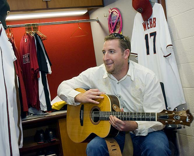 Diamondbacks pitcher Brandon Webb turns to his guitar for solace after being bounced from the playoffs.