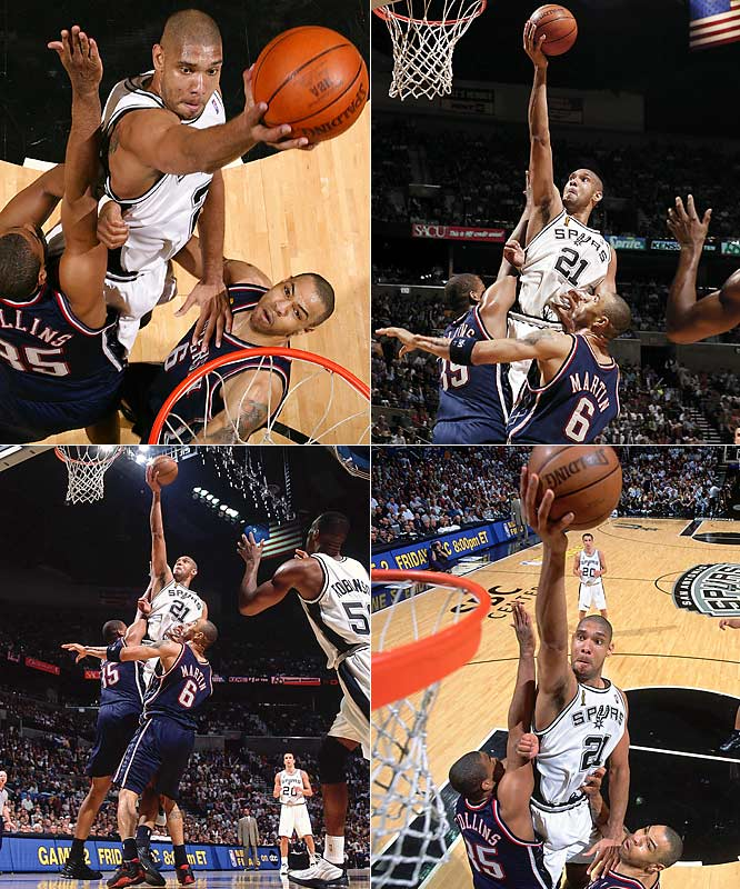 Using a multitude of remote setups and strobe lights to capture high quality images from a variety of angles makes photographing basketball challenging yet rewarding. This shot of Tim Duncan during the NBA Finals was made from several angles (four shown here) with different cameras. All of the angles illustrate Duncan's dominance splitting the two defenders at full extension as he drives to the basket. One was SI's Spurs commemorative cover shot. <br><br>Shot with: Canon EOS-1DS, EF 70-200mm f/2.8L IS USM zoom, shot at 1/250 f/5.6