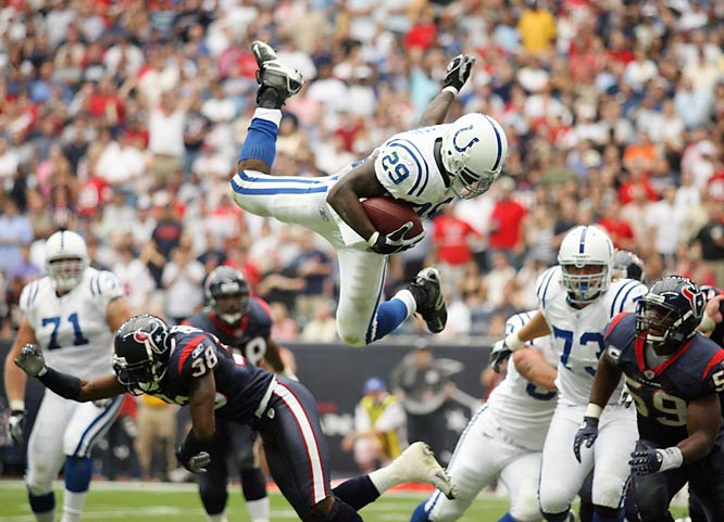 This image of Joesph Addai leaping over the Texans to score was made after I noticed his cutback. I was fortunate to see him plant his foot right before he leaped. This gave me an indication he was going up, and luckily I kept him in the frame. <br><br>Shot with: Canon EOS-1D Mark II N, EF 70-200mm f/2.8L USM zoom, shot at 1/1000 f/2.8