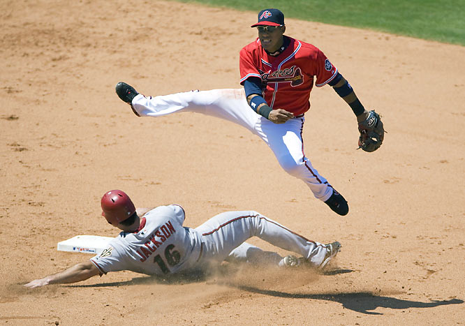 I love making images from different or unique locations; it has always been a priority in my photography. I was fortunate to be shooting from the concourse at Turner Field when Atlanta shortstop Yunel Escobar turned this spectacular double play. <br><br>Shot with: Canon EOS-1D Mark III, EF 600mm f/4.0L IS USM, shot at 1/2000 f/4.0