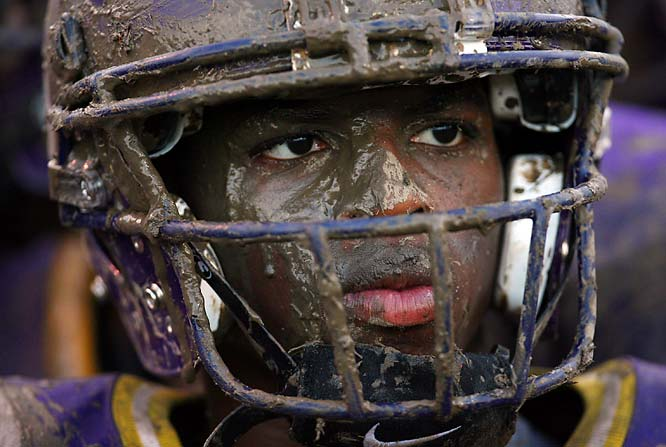 I originally did this picture story for SI for Kids as St. Augustine High in New Orleans was playing its first game in over a year after the school was devastated by Katrina. The field was total mud from a heavy rain. I was looking for various features on the sideline to illustrate how covered in mud the kids were when I saw the pensive look on this kid's face during the game.  I felt the tight image would best convey that.<br><br>Shot with: Canon EOS-1D Mark II N, EF 400mm f/2.8L IS USM, shot at 1/400 f/2.8