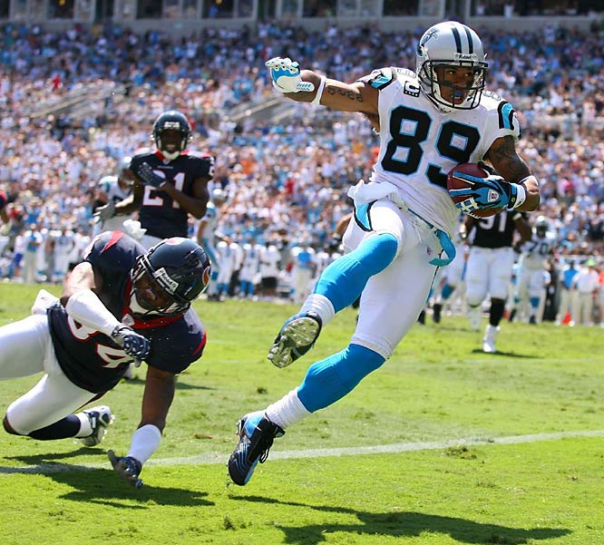 One of the great advantages of digital photography is the spectacular reproduction of the shadow areas. The backlit image here is Steve Smith from the Panthers as he broke open to score a touchdown against the Texans. The great detail in the face and highlights offer a beautiful spectacle to the image.<br><br>Shot with: Canon EOS 1D Mark II N, EF 70-200mm f/2.8L USM zoom, shot at 1/1000 f4.0