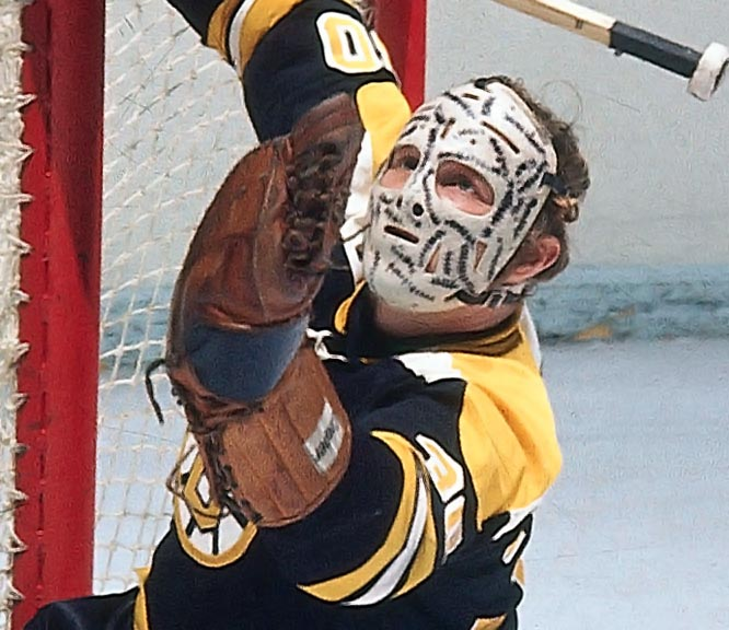 """The goalie sported this scary mask while playing with the Boston Bruins in the 1970's. Stitches, representing where Cheevers would have likely been cut had he not wore the mask, were added in black marker each time he  took one in the face or on the noggin."""""""