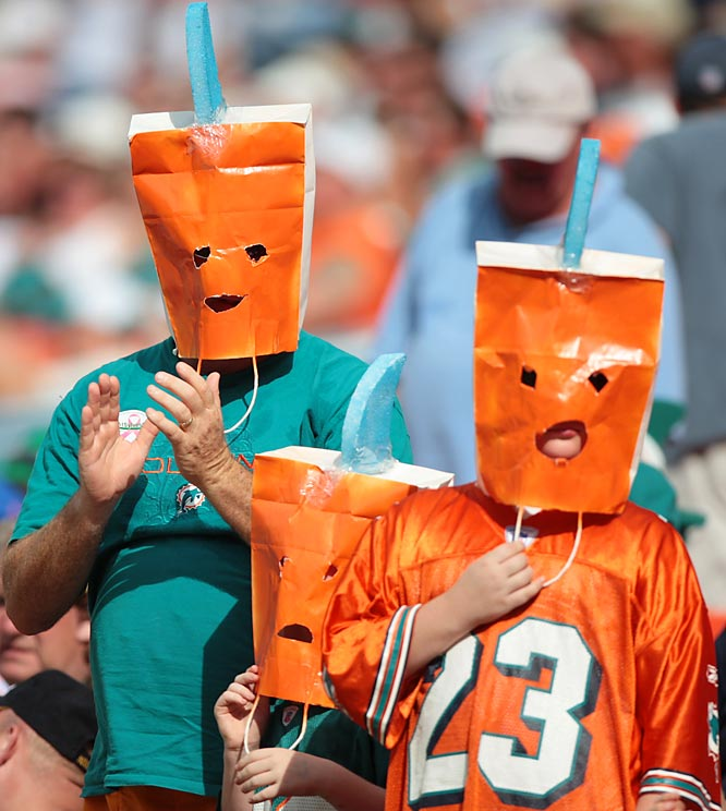 Can you blame these Dolphin fans for hiding their faces following a Week 7 mauling by the Patriots? And the season is only going to get uglier.