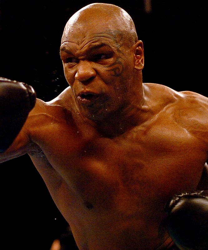 """Claiming he didn't like how his face was looking, Mike Tyson got a tribal  tattoo prior to his 2003 fight against a tomato can named Clifford Etienne. """"I just wanted to put something on my face,"""" said Tyson, who beat Etienne 49 seconds into round one, his final professional victory in the ring. In more frightful news that night,  just before Tyson and Etienne entered the ring, Tonya Harding made her pro boxing  debut."""