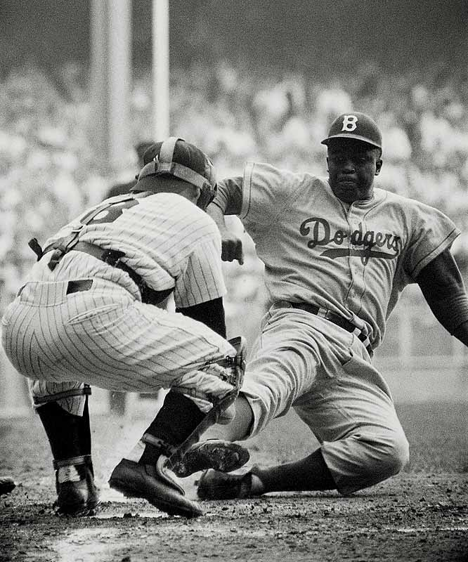 Jackie Robinson stole home in the eighth inning, barely beating the tag of Yankees catcher Yogi Berra. Or did he? Film later showed Robinson should have been called out. The Dodgers ended up losing the game to the Yankees anyway, 6-5, but bounced back to win their first World Series, beating New York in seven games.