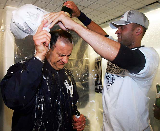 Torre and Derek Jeter celebrate the Yankees' last postseason series victory under Torre. New York defeated Minnesota in the 2004 ALDS.
