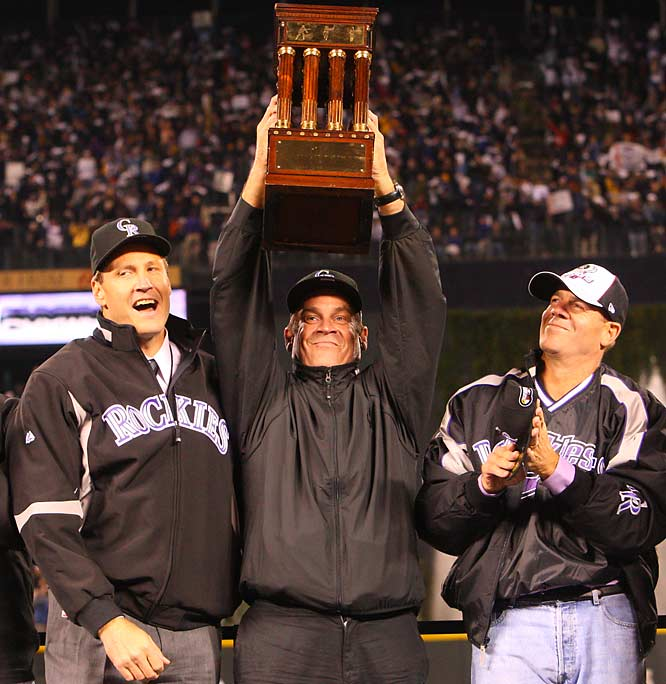 Amid the celebration Rockies owner Charles K. Monfort hoisted the National League championship trophy.