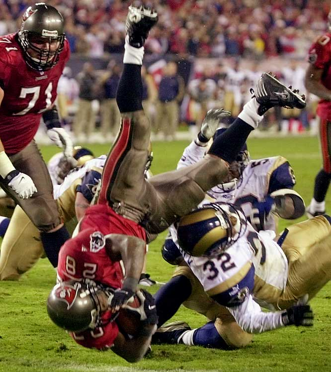 With 1:55 remaining in a rematch of the 1999 NFC title game, Tampa Bay trailed 31-28 after blowing a 10-point lead in the fourth quarter. Shaun King took a snap on second down and threw laterally to Warrick Dunn, who was seemingly wrapped up for an 11-yard loss. But before going down, Dunn lateraled back to King, who sprinted for the first down to keep the drive alive. The Bucs continued to march 80 yards with no timeouts in under two minutes to secure the win.<br><br>Send comments to siwriters@simail.com