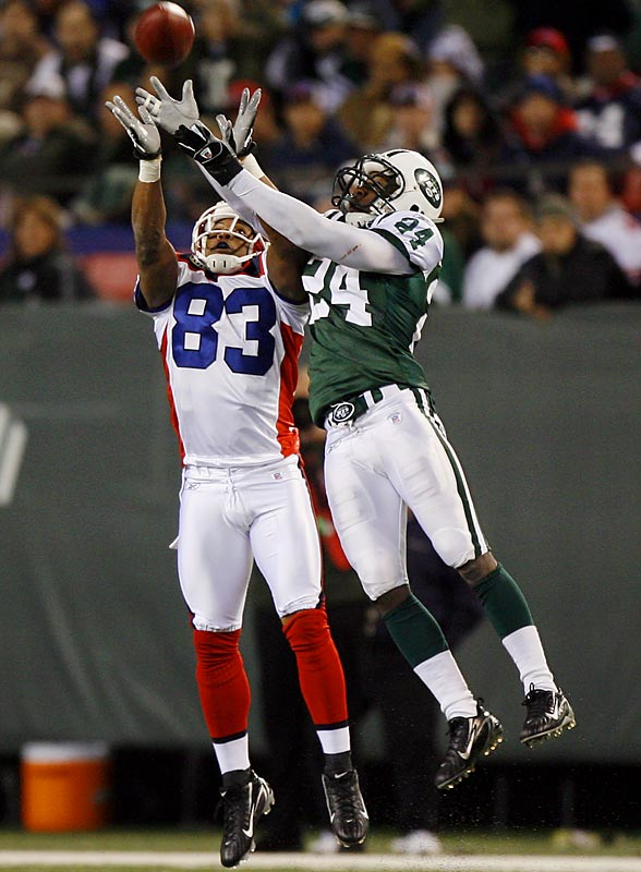 Lee Evans and Jets rookie cornerback Darrelle Revis leap for a deep pass by Bills quarterback J.P. Losman. Evans tugged the ball away from Revis and zipped into the end zone for an 85-yard touchdown with 3:38 left in the game.