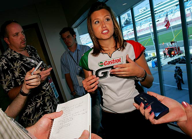 Ashley Force spoke to reporters during a practice for the NASCAR Nextel Cup Series. It looks like she prefers the attention of a TV camera over that of tape recorders and notebooks.