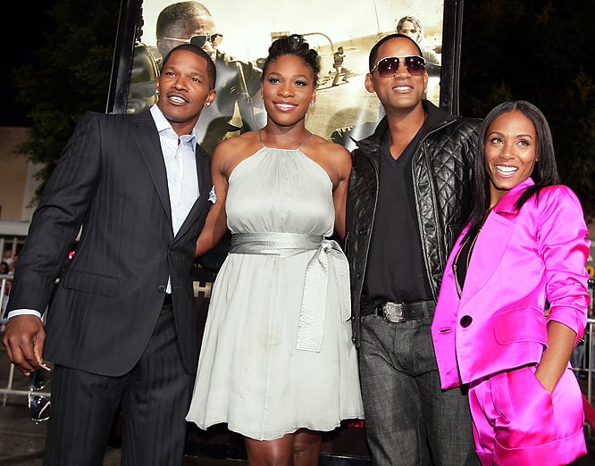 Serena Williams, looking glamorous in a silver cocktail dress, posed with her Hollywood crew: Jamie Foxx, Will Smith and Jada Pinkett Smith, at the premiere of Foxx's new movie, The Kingdom.
